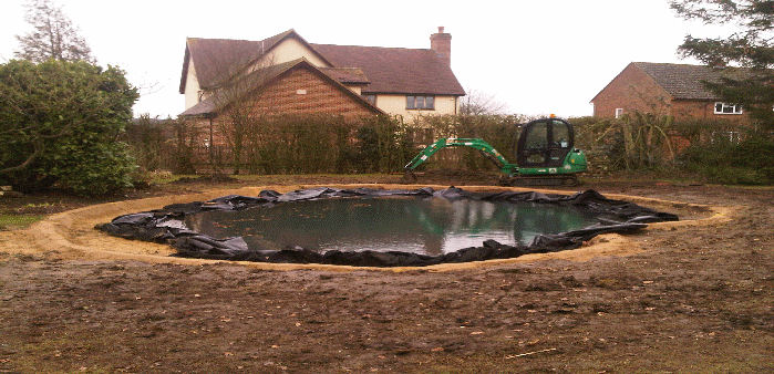 pond with new liner during refurbishment
